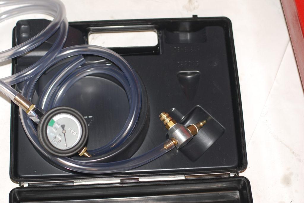 het koelsysteem, een vacuümpomp en vuller